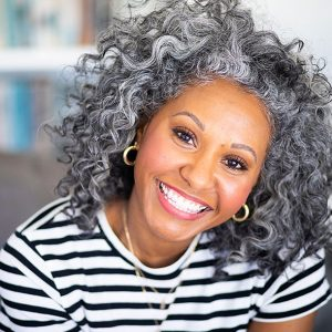 Today's Dentistry - Smiling woman with curly gray hair
